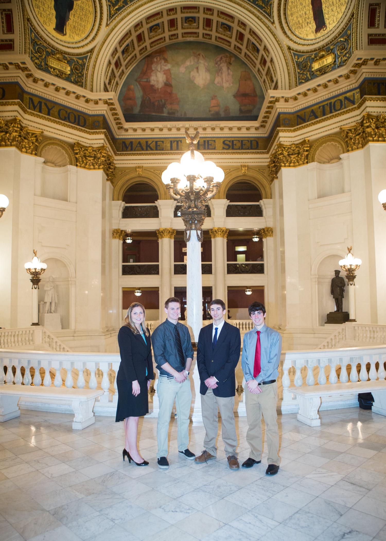 State Representative Tarah Toohil met with Penn State Hazleton students, from left, Charles Ziegmont, Robert Vitagliano and Mauro Notaro.