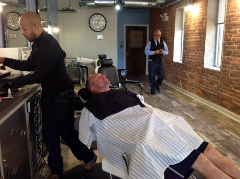 Jimmy's Barbershop, Eric Castro left, Kerry Kulp, in chair, Jimmy Moyer, right.