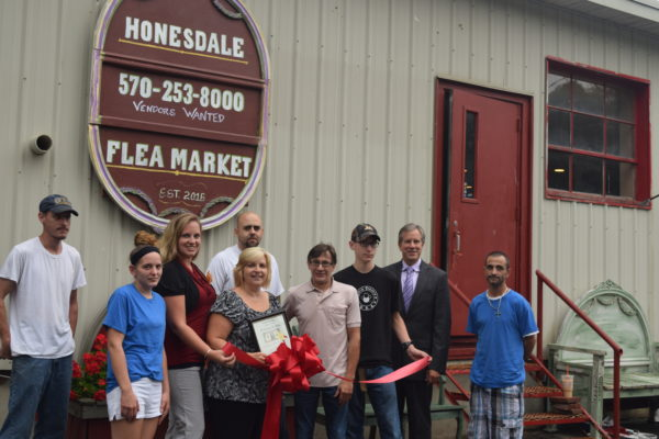 Pictured in photo are Scott O'Dell, Michael Acevedo and Elijah Hanson – employees; Stephen Cable and Catherine MacAdam – Cable's Hot Dogs; Jim Gremli – owner; Lew Critelli,  Jennifer DeYoung and Debbie Gillette – The Chamber of the Northern Poconos