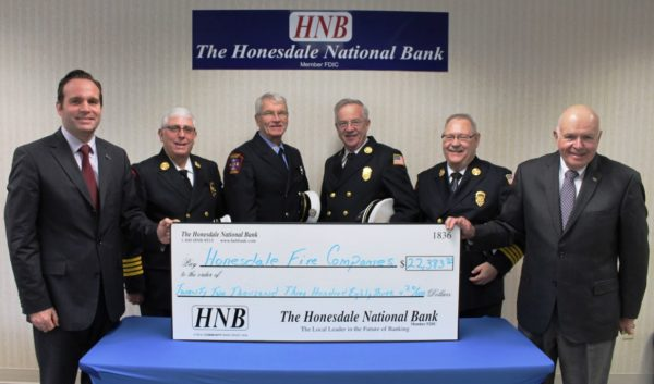 Pictured are (l to r): Charles Curtin, JD, LLM and HNB Trust Officer; Jerry Theobald, Hose Co #1Chief; Donald Matthews, Alert Hook and Ladder #2 Chief; Stan Pratt, Protection Engine Co #3 Chief; Paul Lautenschlager, Texas #4 Chief; and Paul Meagher, co-Trustee.